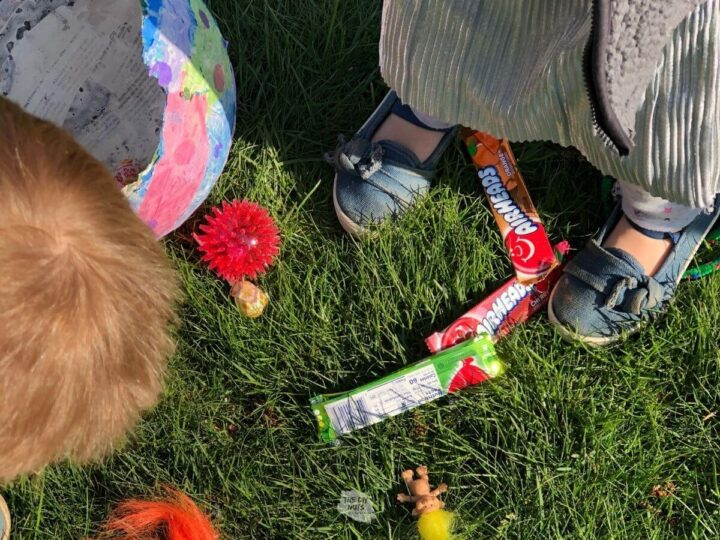 children feet and candy after hitting a homemade piñata